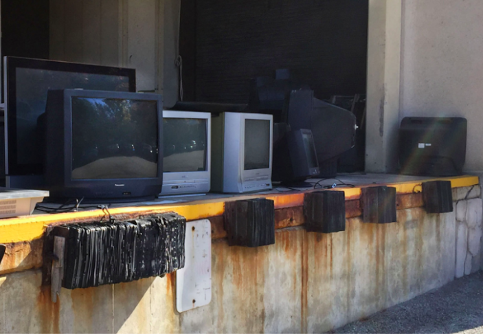TVs+sitting+in+the+loading+dock+behind+the+JKM+Library+in+December+2019.