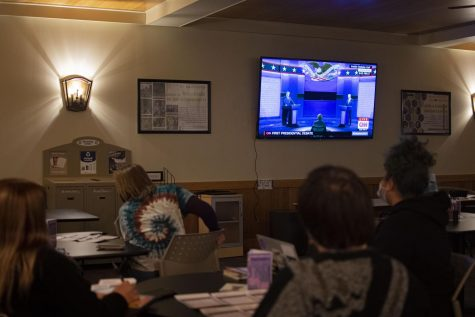 Students watch the first presidential debate in the Carriage House on Tuesday, Sept. 29, 2020. The Pennsylvania Center for Women and Politics held a debate watch party and gave students the option to either view it in the Carriage House or pick up a party pack and tune in from their dorms.