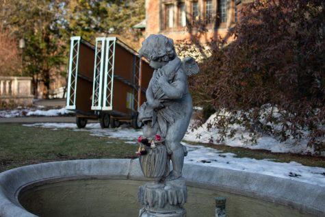 The statue in the Mellon courtyard stands in front of some pieces of the Netflix set left outside. Photo Credit: Lilly Kubit.