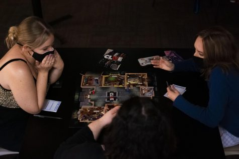 Students play Clue in the Carriage House.  Photo Credit: Lilly Kubit