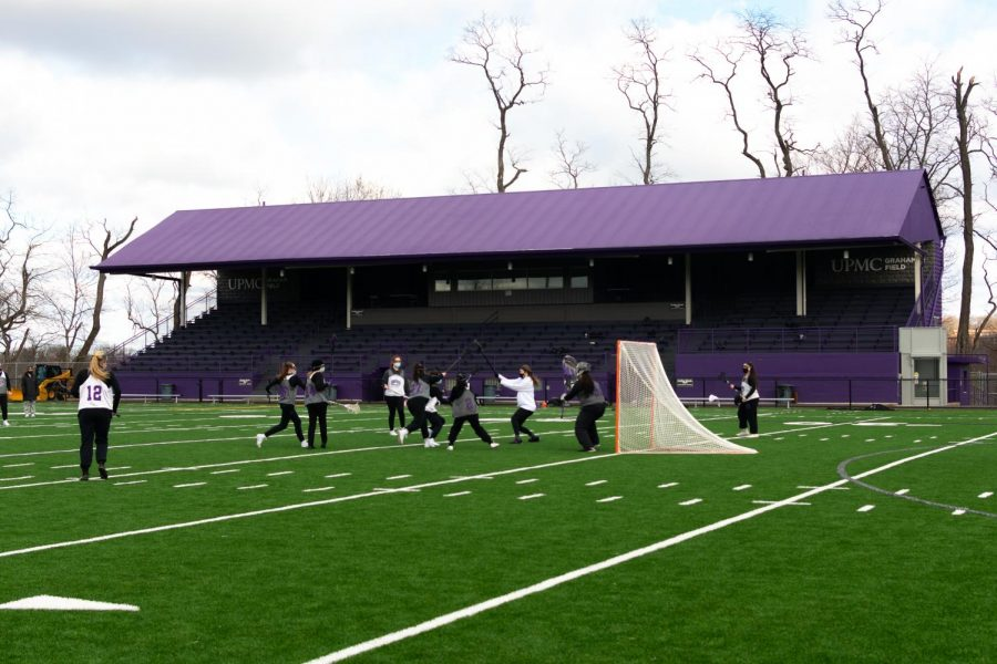 Women's lacrosse team practices at Graham Field.