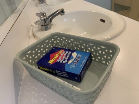 Menstrual products in Falk Hall women's bathroom. Photo Credit: Abbey Sullivan