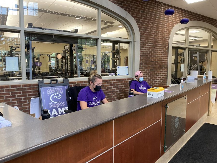 Student employees Anna Predergast '22, left, and Jacob Tebay '25 work the front desk in the Athletic & Fitness Center. Photo Credit: Gena Carter